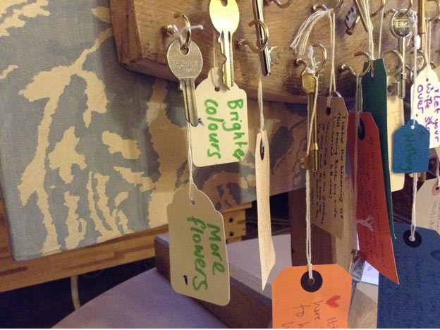 Residents were asked 'What makes this place feel like home? They wrote their responses on keyrings and hung them on a tailor made key rack that travelled from home to home.