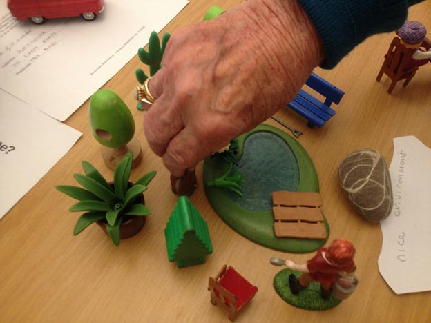 Resident in one of Torbay's Residential Care Homes creating a model of their ideal care home.